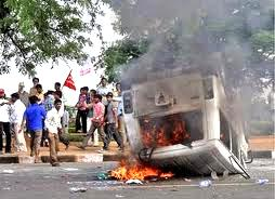 angry agitators burning vehicles