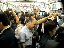 straphangers on a crowded train